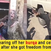 women tearing her burqa